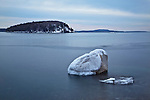 """A solitary glacial erratic, called """"Balance Rock,"""" sits in the calm waters of Frenchman Bay in Bar Harbor, Maine, USA"""