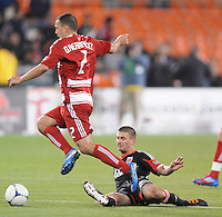 D.C. United midfielder Perry Kitchen (23) slides to make a save against FC. Dallas midfielder Daniel Hernadez (2)  D.C. United defeated FC Dallas 4-1 at RFK Stadium, Friday March 30, 2012.