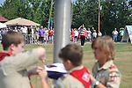 The crowd watches as Boy Scouts raise the flag at the dedication of the new Veterans Park in Oxford, Miss. on Saturday, June 30, 2012.