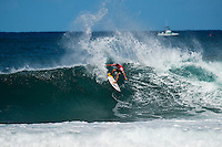 North Shore, Oahu, HAWAII - (Sunday, Nov. 24, 2013) Adriano de Souza (BRA). -- Tahiti's Michel Bourez has won the REEF Hawaiian Pro, the $40,000 prize purse, and takes an early lead of the Vans Triple Crown of Surfing hydrated by vitaminwater&reg;. Bourez, 27, built momentum through the earlier rounds of this competition and was clearly unstoppable by the final. He survived a late charge by Haleiwa local Fred Patacchia, 31, and was well clear of Jeremy Flores (France) and Dion Atkinson (Australia), who finished third and fourth respectively.<br /> This is Bourez's second victory at the REEF Hawaiian Pro, having first won here in 2008. His combination of stylish power surfing and impeccable wave selection made him the man to beat through the final rounds of competition today. A strong surfer in big waves and a great Tahitian tube rider, he is definitely capable of winning the Vans Triple Crown this year.<br /> The most relieved athlete today was Dion Atkinson, 27, from South Australia. Atkinson entered the REEF Hawaiian Pro with work to be done if he is to qualify for the 2014 elite ASP World Championship Tour. With this result, he climbed into qualification position today, has taken off a little pressure going into Sunset, and will now be looking to maintain form in order to make his pro surfing dreams come true.  Photo: joliphotos.com