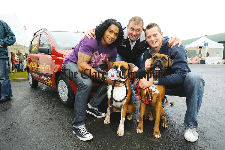 Leimfi Mafi and Denis Hurley, Munster Rugby stars with some friendly canines during their visit to The County Clare Show, as Fiat Ambassadors for the official opening of Hayes of Ennis, new Fiat dealer. .. Photograph by John Kelly.