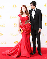 LOS ANGELES, CA, USA - AUGUST 25: Actress Christina Hendricks and Geoffrey Arend arrive at the 66th Annual Primetime Emmy Awards held at Nokia Theatre L.A. Live on August 25, 2014 in Los Angeles, California, United States. (Photo by Celebrity Monitor)