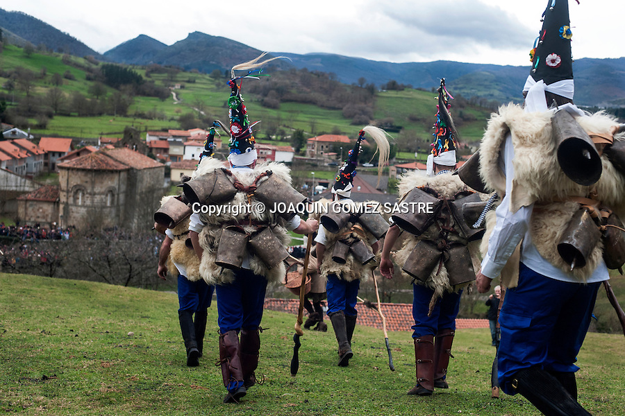 The zarramacos honking their roads lead to the village of Silio (Cantabria) for the carnival Vijanera the first winter carnival that takes place in Spain