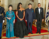 United States President Barack Obama, right, and First Lady Michelle Obama, center left, and President XI Jinping of China, center right, and Madame Peng Liyuan, left, pose for a formal photo prior to a State Dinner in their honor in front of the Grand Staircase of the White House in Washington, DC on Friday, September 25, 2015.<br /> Credit: Ron Sachs / CNP