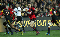 Crusaders' Adam Whitelock fends off a challenge from Chiefs' Aaron Cruden in the semi-final Super Rugby match, Waikato Stadium, Hamilton, New Zealand, Friday, July 27, 2012.  Credit:SNPA / David Rowland