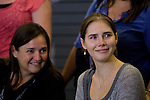 Amanda Knox, right, and her mother Edda, smile at a crowd of supporters during a news conference held  at the Seattle-Tacoma International Airport near Seattle, Washington on October 4, 2011. Knox arrived in the United States after departing Rome's Leonardo da Vinci airport,. Knox's life turned around dramatically Monday when an Italian appeals court threw out her conviction in the sexual assault and fatal stabbing of her British roommate.  ©2011. Jim Bryant Photo. All Rights Reserved.