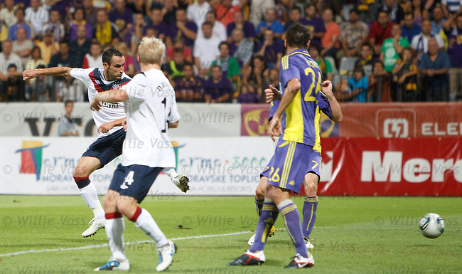 Juan Manuel Ortiz flicks in the opening goal for Rangers in Maribor but it is about to turn sour for the Govan Globetrotters in Slovenia.