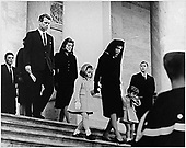United States President John F. Kennedy's Family leaves the U.S. Capitol after Ceremony on November 24, 1963.  (L-R)Caroline Kennedy, Jacqueline Bouvier Kennedy, John F. Kennedy, Jr. (2nd row) Attorney General Robert F. Kennedy, Patricia Kennedy Lawford (hidden) Jean Kennedy Smith (3rd Row) Peter Lawford. <br /> Credit: JFK Library via CNP