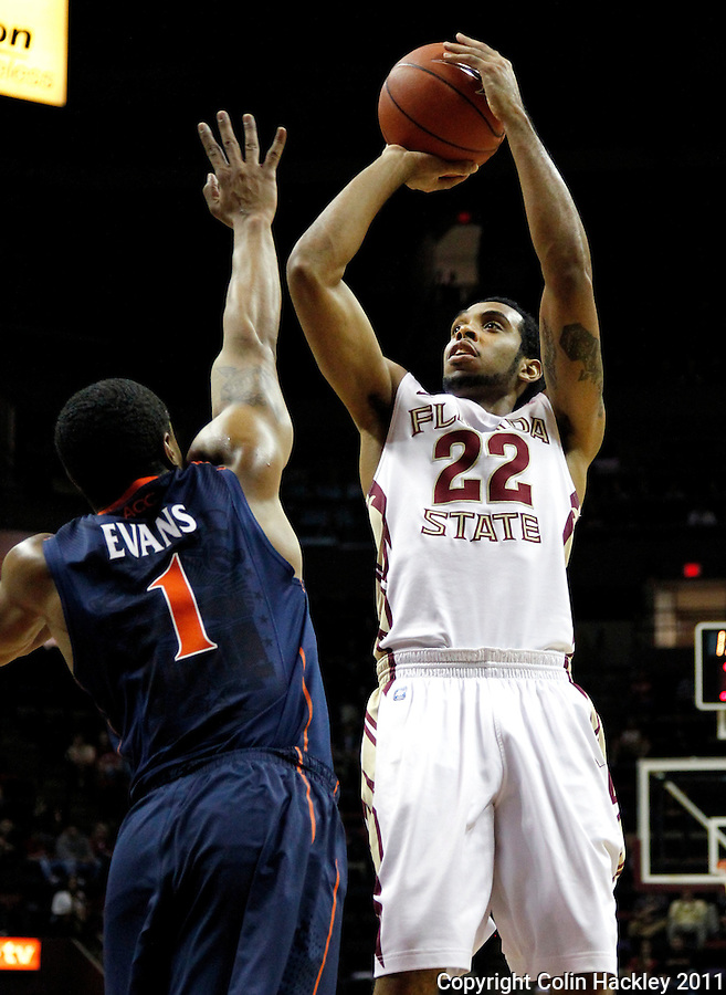 TALLAHASSEE, FL 10-FSU-VA MBB11 CH-Florida State's  Derwin Kitchen shoots over Virginia's Jontel Evans during first half action Saturday at the Donald L. Tucker Center in Tallahassee...COLIN HACKLEY PHOTO