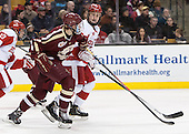 Brendan Silk (BC - 9), T.J. Ryan (BU - 3) - The Boston College Eagles defeated the Boston University Terriers 3-1 (EN) in their opening round game of the 2014 Beanpot on Monday, February 3, 2014, at TD Garden in Boston, Massachusetts.