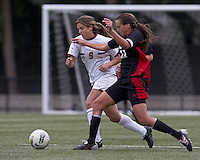 Boston College forward Stephanie McCaffrey (9) brings the ball forward as NC State defender Paige Dugal (11) pressures. Boston College defeated North Carolina State,1-0, on Newton Campus Field, on October 23, 2011.
