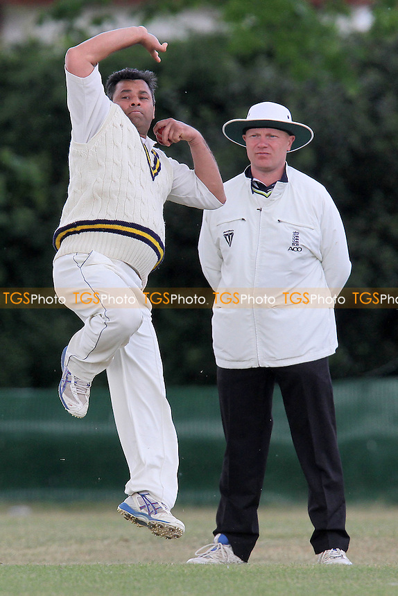 M Elahi in bowling action for Ardleigh Green - Ilford CC (batting) vs Ardleigh Green CC - Essex Club Cricket at Valentines Park - 14/05/11 - MANDATORY CREDIT: Gavin Ellis/TGSPHOTO - Self billing applies where appropriate - Tel: 0845 094 6026