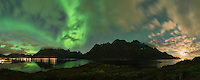 Northern lights shine in sky over Sildpollnes and Austnesfjord, Austvågøy, Lofoten Islands, Norway