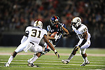 Ole Miss wide receiver Korvic Neat (28) vs. Vanderbilt safety Javon Marshall (31) and Vanderbilt safety Karl Butler (28) at Vaught-Hemingway Stadium in Oxford, Miss. on Saturday, November 10, 2012. (AP Photo/Oxford Eagle, Bruce Newman)