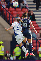 Glasgow, Scotland - July 25, 2012: Carli Lloyd wins a header during the US women's soccer team's win against France, 4-2.