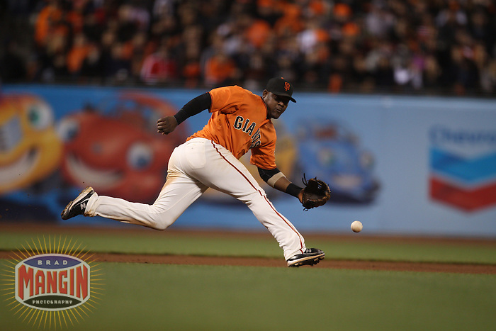 SAN FRANCISCO - October 1:  Juan Uribe of the San Francisco Giants makes a play at third base against the San Diego Padres during the game at AT&T Park on October 1, 2010 in San Francisco, California. (Photo by Brad Mangin)