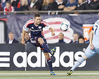 New England Revolution midfielder Kelyn Rowe (11) passes the ball.  In the first game of two-game aggregate total goals Major League Soccer (MLS) Eastern Conference Semifinal series, New England Revolution (dark blue) vs Sporting Kansas City (light blue), 2-1, at Gillette Stadium on November 2, 2013.