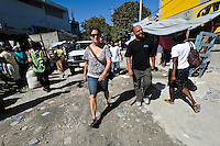 Andy Chaggar and partner Emma Taylor walking in Delmas, Port-au-Prince, Haiti. EDV is committed to affecting permanent change in disaster-affected communities worldwide. Their role is to facilitate personal connections between volunteers and the survivors of disasters.  The charity is based on a proven model developed by several landmark organisations that have paved the way for citizens to become disaster volunteers. These landmark organisations have shown that supposedly ordinary people working together with the guidance of knowledgeable leaders can make an extraordinary difference in the lives of those affected by disaster..EDV believe that to provide meaningful relief and reconstruction assistance to disaster affected communities they have to do more than reconstruct buildings. They need to understand and address the factors that made a community vulnerable to the disaster in the first place. The charity's work is organised with these factors in mind so that they can affect change that far outlives their presence..EDV believes that survivor motivation is essential to the recovery of any disaster-affected community. Their operations will always be predicated on the idea that survivors may be traumatised, but they are not helpless. With this in mind, EDV encourages host communities to direct their own recovery. EDV believe that this empowerment is essential in helping survivors feel a renewed sense of control over their lives which will, in turn, help overcome the feelings of hopelessness that can follow a disaster and inhibit long term recovery. EDV also believe that social cohesion is of primary importance in any disaster-affected area. No amount of bricks or mortar will bring about sustainable improvement if communities fail to come together or are disrupted by relief efforts. Therefore, their operations will always aim to foster communication and cooperation within and between the communities they serve.
