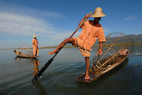 Traditional fishing on the 22 km long, 11 km wide Inle Lake. These fishermen are more for show than for catching fish. Tourists stop to take pictures, and hopefully, tip. There have been calls from the international community for tourists to boycott Burma, as it maintains the country's military junta.