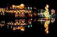 NIght view  of Hoi An along the Thu Bon River, with dragon float reflection.