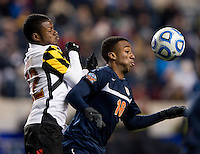 Suli Dainkeh (22) of Maryland applies pressure to M. Salandy-Defour (16) of Virginia during the NCAA Men's College Cup semifinals at PPL Park in Chester, PA.  Maryland defeated Virginia, 2-1.