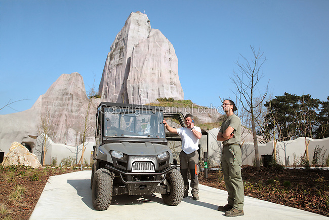 Staff members Fabrice, Bernard and Matthieu awaiting instructions with their Polaris electric 4x4 vehicle, with the Grand Rocher or Great Rock behind, at the new Parc Zoologique de Paris or Zoo de Vincennes, (Zoological Gardens of Paris or Vincennes Zoo), which reopened April 2014, part of the Musee National d'Histoire Naturelle (National Museum of Natural History), 12th arrondissement, Paris, France. Picture by Manuel Cohen