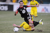 D.C. United midfielder Chris Pontius (13) gets fouled.  D.C. United defeated The Columbus Crew 1-0 at RFK Stadium, Saturday August 4, 2012.