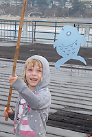 Delphine Gregory, 5, and her brother Caleb, 2, fish at the Santa Monica Pier during the  Santa Monica Jaycees (Santa Monica Junior Chamber)  55th annual Huck Finn Day on Saturday, October 2, 2010.