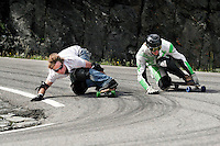 Eirik Waage (left) battles Dan Øverland in a post competition run down the mountain. The first ever Norwegian Longboarding Championship was held during the Extreme Sport Week, an annual event that draws adrenalin junkies to the small Norwegian mountain town of Voss. © Fredrik Naumann