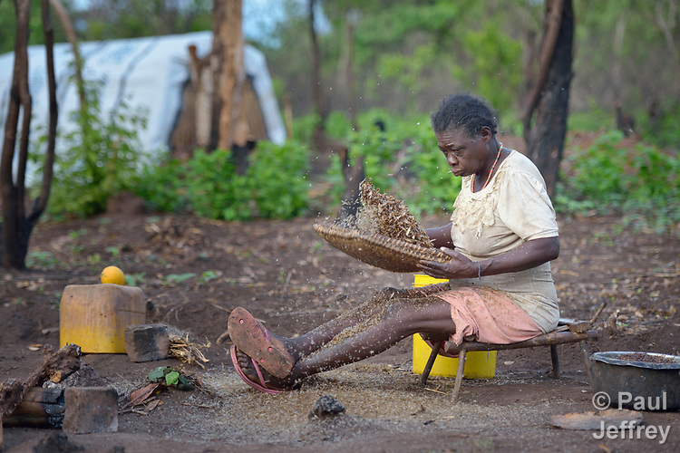 Grace Janje winnows termites --separating the wings from the edible body -- in a camp for for than 5,000 displaced people in Riimenze, in South Sudan's Gbudwe State, what was formerly Western Equatoria. Families here were displaced at the beginning of 2017, as fighting between government soldiers and rebels escalated.<br /> <br /> Two Catholic groups, Caritas Austria and Solidarity with South Sudan, have played key roles in assuring that the displaced families here have food, shelter and water.<br /> The camp formed around the Catholic Church in Riimenze as people fled violence in nearby villages for what they perceived as the safety offered by the church.
