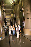 Chile Wine Country: Vertical of stainless steel tanks and tour group at Undurraga Winery, Vina Unudurraga, near Santiago..Photo #: ch430-32832..Photo copyright Lee Foster, 510-549-2202, www.fostertravel.com, lee@fostertravel.com.