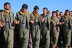 QANDIL, IRAQ: PKK fighters dance during Newroz celebrations in the PKK controlled area of Qandil in the north of Iraqi Kurdistan...On March 21st 2013, during the Kurdish new year festival of Newroz, jailed PKK (Kurdish Workers Party) leader Abdullah Ocalan released a statement calling on the PKK to cease hostilities and withdraw from Turkey back to northern Iraq...Photo by Aral Kakl/Metrography