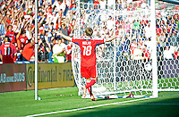 Chicago forward Chris Rolfe (18) celebrates after scoring Chicago's third goal.  The Chicago Fire defeated the New York Red Bulls 3-1 at Toyota Park in Bridgeview, IL on June 17, 2012.