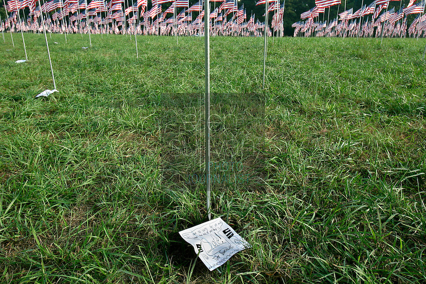 A letter left by a child sits among 2,996 flags placed at Kennesaw Mountain National Battlefield Park by the Kiwanis Club of Marietta in remembrance of people who died in the terrorist attacks of five years ago.<br />