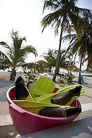 Belize, Central America - Basin full of swim fins outside a dive center on Caye Caulker
