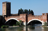 General view of the bridge over the Adige River, Castelvecchio, 1354-79, Verona, Italy. The castle, built with its bridge, for Cangrande II,  stands on the probable site of a Roman fortress. The fortified bridge was intended as an emergency escape route for the Scala family towards the Tyrol. The castle, where Napoleon stayed, was damaged  during the Pasque Veronesi, Napoleonic Wars (1796-97). Castelvecchio was restored in 1923 and 1963-65. Picture by Manuel Cohen.