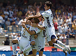 UNAM Pumas striker Fernando Morales is hugged by Bruno Marioni (2nd L), Leandro Augusto and  Jose Toledo (R) after scoring the victory goal against Chiapas Jaguares during their soccer match at the University Stadium, April 02, 2006. UNAM Pumas won 2-1 to Chiapas Jaguares.  Photo by © Javier Rodriguez