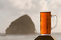 Pelican Pub's microbrew India Pelican Ale and Haystack Rock; Pacific City, Oregon Coast.