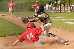 BEACON FALLS,  CT-051817JS35-Wolcott's Alex Calabro (44) slides into home to score in front of the tag by Woodland's Colby Linnell (14)  during their game Thursday at Woodland Regional High School in Beacon Falls. <br /> Jim Shannon Republican-American