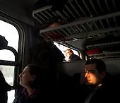 CENTRAL POLAND, FEBRUARY 2012:.Train to Warsaw. About 500 thousand people commute everyday from other towns and villages to work in the Polish capital..(Photo by Piotr Malecki / Napo Images)..Luty 2012:.Megi wychyla sie przez okno. Po lewej siedzi Zofia. Pociag do Warszawy. Okolo 500 tysiecy osob dojezdza codziennie z innych miast do pracy w Warszawie.  .Fot: Piotr Malecki / Napo Images.