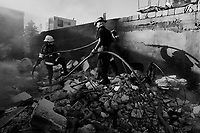 Port Au Prince, Haiti, Jan 17 2010.The Port au Prince firebrigade has to intervene several times a day to put out fires, many of wich started as people burned bodies in the ruines..