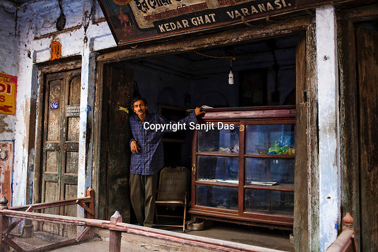 A sweetshop owner stands in his shop in the ancient city of Varanasi in Uttar Pradesh, India. Photograph: Sanjit Das/Panos