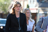 Defendants Allison Coss and Scott Sippola in Marquette Michigan Michigan walk to the federal court house for their extortion trial.