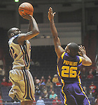 "Ole Miss guard Chris Warren (12)  makes a three pointer over Louisiana State's Daron Populist (25) at the C.M. ""Tad"" Smith Coliseum in Oxford, Miss. on Wednesday, February 9, 2011. Ole Miss won 66-60 and is now 4-5 in the Southeastern Conference."