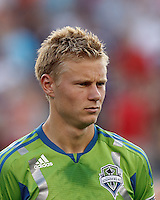Seattle Sounders FC midfielder Andy Rose (25). In a Major League Soccer (MLS) match, the New England Revolution tied the Seattle Sounders FC, 2-2, at Gillette Stadium on June 30, 2012.