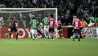 BOGOTA - COLOMBIA: 27-07-2016: Miguel Borja (Der.) jugador de Atletico Nacional de Colombia anota gol a Libardo Azcona (Cent.) portero de Independiente Del Valle de Ecuador, durante partido de vuelta de la final, entre Atletico Nacional e Independiente Del Valle por la Copa Bridgestone Libertadores 2016 en el Estadio Atanasio Girardot, de la ciudad de Medellin. / Miguel Borja (R) player of Atletico Nacional of Colombia, scored a goal to Libardo Azcona (C) goalkeeper of Independiente Del Valle de Ecuador, during a match for the second leg for the final between Atletico Nacional and Independiente Del Valle for the Bridgestone Libertadores Cup 2016, in the Atanasio Girardot Stadium, in Medellin city. Photos: VizzorImage / Luis Ramirez / Staff.