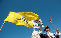UNITED STATES - APRIL 6: Tea party activist John Oltesvig, of North Carolina, wears a colonial costume with a tri-corner hats as he participates in the rally at the Capitol on Wednesday, April 6, 2012, days before a possible federal government shutdown. (Photo By Bill Clark/Roll Call)