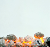 BURNING CHARCOAL BRIQUETTES<br />