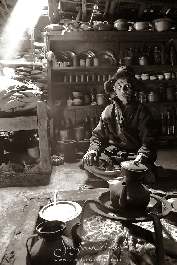 """""""I first saw Shring Lama leading a Tibetan Dance celebrating the final day of the Annual Chame Horse Racing festival. Age 87, he's well respected and the oldest man for many miles. I ask my Nepali companion if he could arrange to visit Shring Lama in his village. Next day we are welcomed us into his home and over a few cups of tea he tells me the story of his life. How he came to Nepal as a young man from Tibet to start a family. I brought offerings of rice and lentils and when Shring Lama insisted on a return gift, I asked quite simply for this photograph."""""""