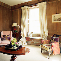 Oak panelled walls, hidden for years under wallpaper, cover the walls of the King's Room which was once Henry James' bedroom